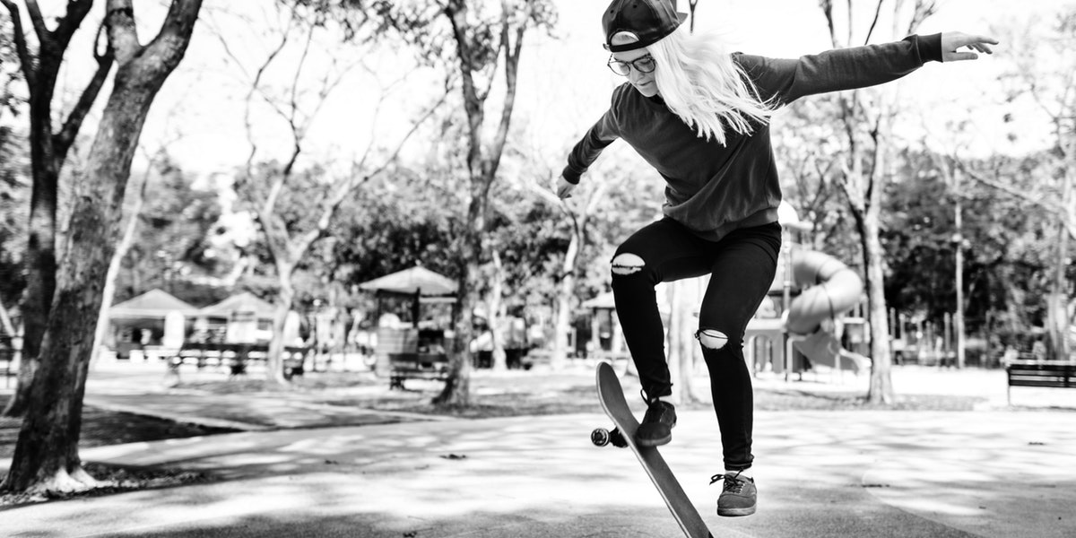 Student performing a stunt on her skateboard
