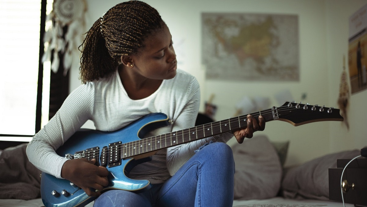 Student with a guitar